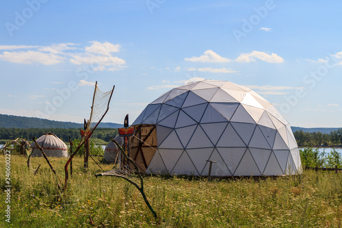 white geodesic dome on a sunny summer day in field Fototapeta