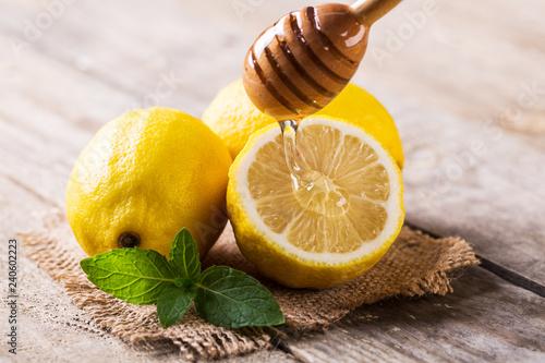 Closeup of lemon and honey on wooden table Wallpaper Mural