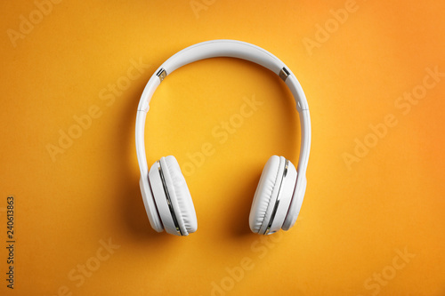 Fotografie, Obraz  Wireless headphones on color background, top view
