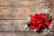Flat Lay Composition With Poinsettia And Space For Text On Wooden Background. Traditional Christmas Flower