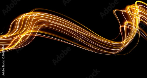 Fototapety, obrazy: Long exposure light painting photography, curvy lines of vibrant neon metallic yellow gold against a black background