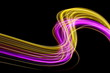 canvas print picture - Long exposure, light painting photography. Pink and gold neon streaks of vibrant color against a black background
