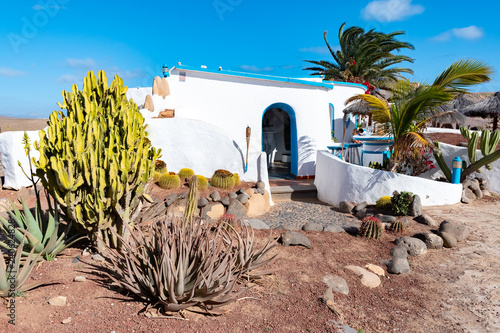 Photo Stands Canary Islands Typical tiny Canarian house with cactus garden on Papagayo beach on the island of Lanzarote, Canary Islands, Spain
