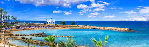Poster Beach Cyprus island - best beaches. Scenic Louma beach with little church