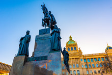 St. Wenceslas Statue In Prague Center. Knight On The Horse Near Main Prague Square. Museum Historical Building In Background. One Of Czech National Symbols
