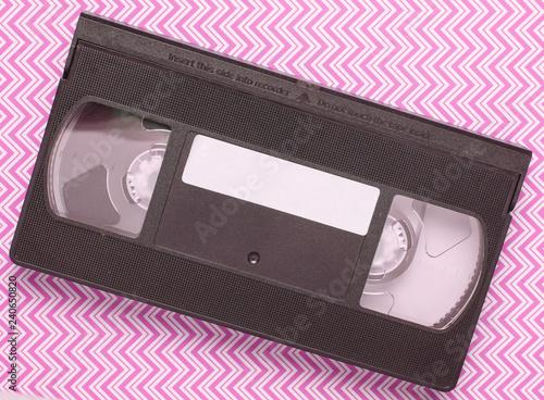 Cuadros en Lienzo Video cassette on blue creative background, media 80s. Top view..