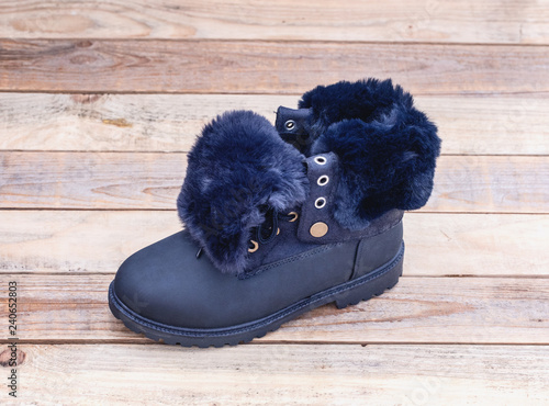 98cab867fdd146 Leather fur lined boot at wood background - Buy this stock photo and ...