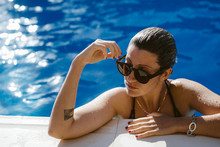 Young Woman In Sunglasses In Pool