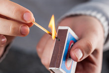 Hold A Matchbox While Striking A Match