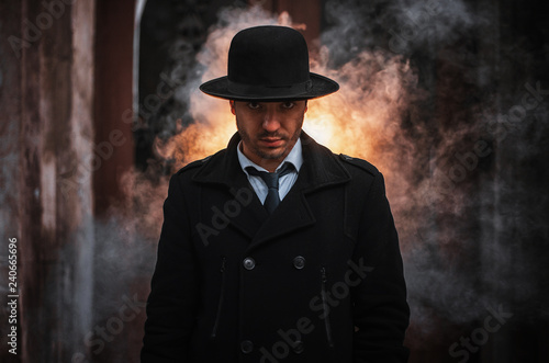 Fotografie, Obraz Young handsome man wearing black hat and classic suit and tie