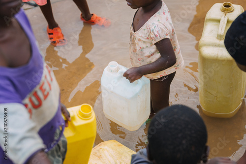Valokuva Children fetching water in Uganda, Africa