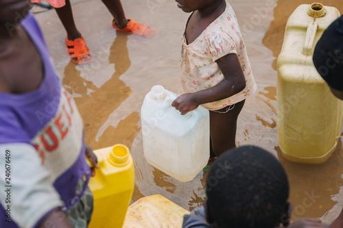 Fotografie, Tablou Children fetching water in Uganda, Africa