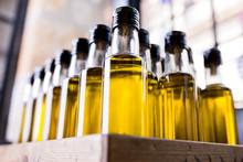 Olive Oil Bottles In Wooden Cr...