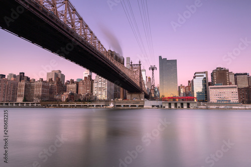 Poster Brooklyn Bridge View on Queensboro bridge with tram at sunrise ,long exposure shot