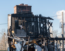 Charred And Blackened Remains Of An Office Building Destroyed By A Fire