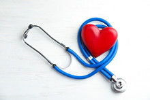 Stethoscope And Red Heart On Wooden Background, Top View. Cardiology Concept