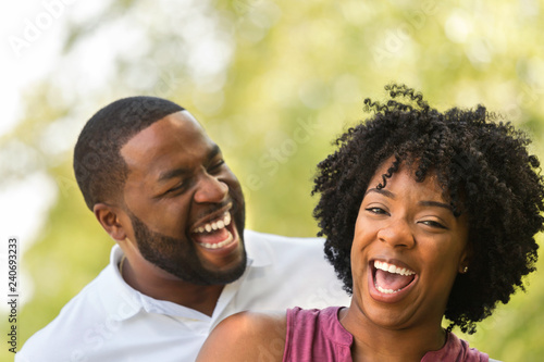 Fotografie, Tablou  Happy African American couple laughing and smiling.