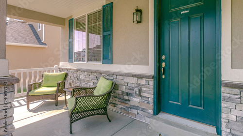 Fotografie, Obraz  Green front door with two armchairs on the porch