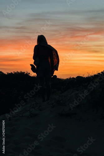 Illumination of a man standing in the sunset Wallpaper Mural