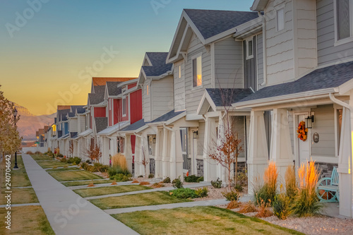 Fotografie, Obraz Townhomes in a row at sunset in Utah Valley