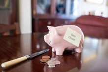 Pink Piggy Bank On Table With ...