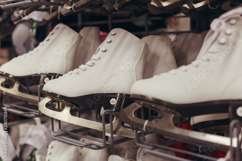 Fotomural  White skates stand for sale on the shelf of shop