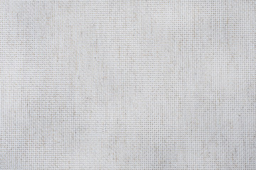 Fabric canvas for cross stitch crafts. Texture of cotton fabric.
