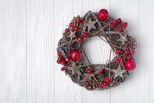 Traditional Christmas Wreath From Twigs, Stars And Pine Cones With Red Decorations