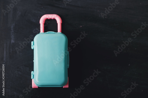 Fototapety, obrazy: Color suitcase on a dark background. Travel concept.