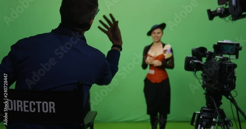 Slow motion shot of a director talking to actor and actress before they perform a scene