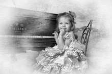 A Little Girl And A Piano