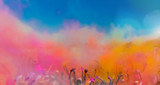 Crowd throwing bright coloured powder paint in the air, Holi Festival Dahan. - 240733667