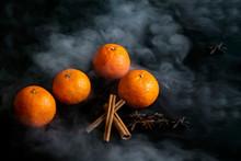 Tangerines And Cinnamon In Smoke