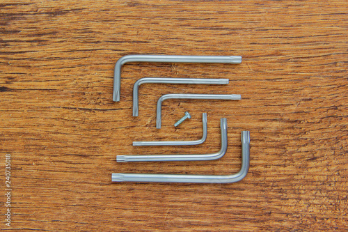 Photo Hex key or allen wrench set on wooden background