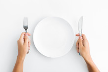 Whte Plate With Silver Fork And Knife On White Background