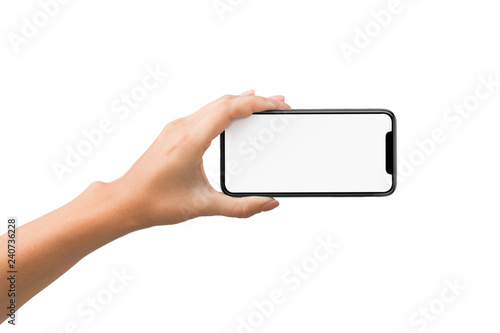 Fotografiet  Woman hand holding smartphone in horizontal orientation