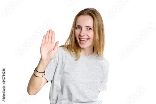 Valokuva  Portrait of a young happy woman showing open hand and five fingers, isolated on white background