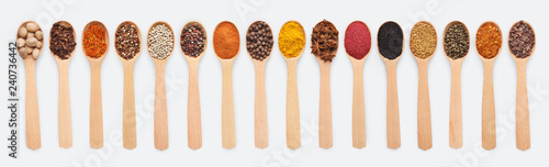 Fototapeta Collage of different seasoning in wooden spoon obraz