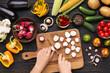 Leinwanddruck Bild - Female hand cutting fresh radishes on board