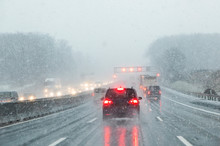 Highway With Cars In Winter With Snow Fall