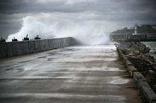 Stormy Surf Breaking On Breakwater