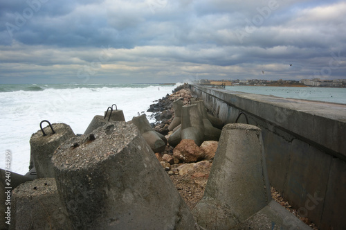 Concrete breakwater in stormy se