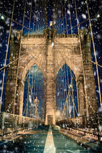 Brooklyn Bridge New York City With Snowflakes Falling During Winter Snow Storm
