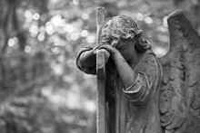 The Sorrowful Angel. Weeping Angel With A Cross, Space For Text