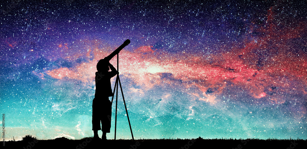 Fototapety, obrazy: Silhouette of little child looking through a telescope