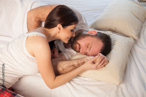 . husband and wife in bed in the morning woke up bedroom   Buy this