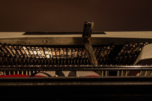 An Old Typewriter. Press A Key And See A Small Arm With The Letter Of The Corresponding Alphabet, Starting From The Pile To Reach The Sheet Of Paper, On Which The Letter Is Printed With Indelible Ink.
