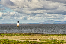 Plover Scar Lighthouse At The Entrance To The Lune Estuary.