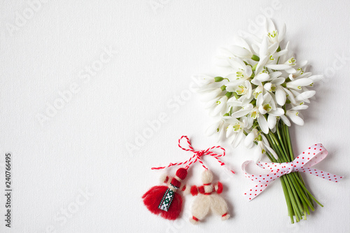 Bouquet of snowdrops on canvas and martisor