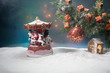 Christmas Decoration - bauble on branch of pine tree with holiday attributes on snow. Selective focus